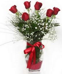 7 adet gülden cam içerisinde güller  Konya çiçek satışı